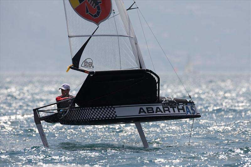Simon Payne on day 6 of the Zhik Nautica Moth Worlds at Campione del Garda. Photo © Th.Martinez / Sea&Co / www.thmartinez.com